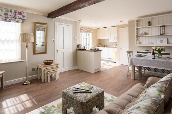 Forge Cottage, Coxwold. Spacious lounge and dining area with open fire