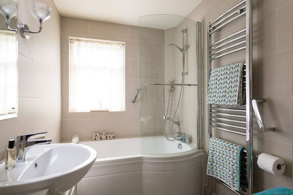 Forge Cottage, Coxwold. Bathroom with bath and over-shower, toiletries, robes and slippers